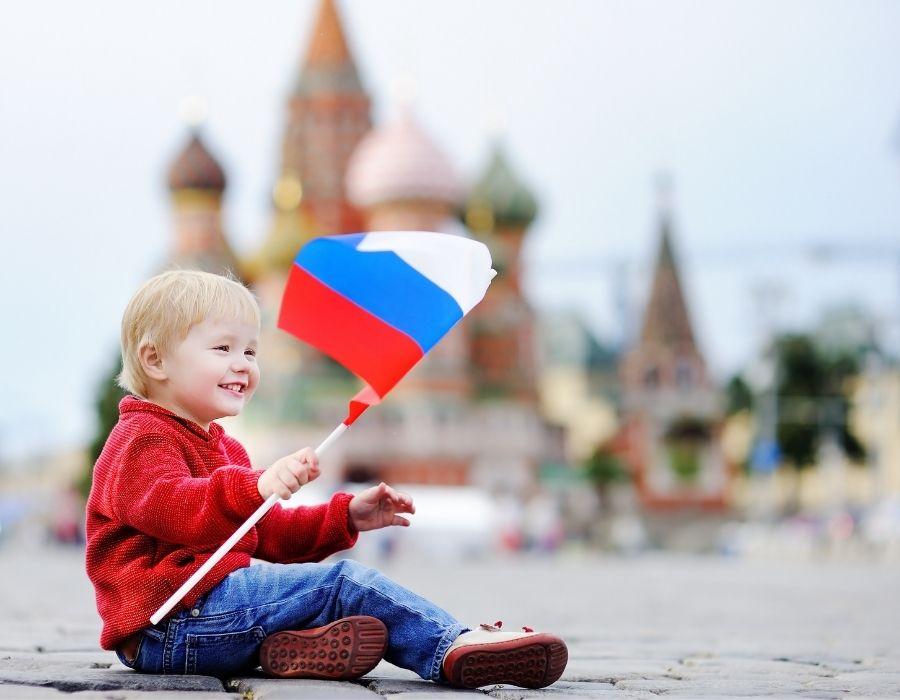 Boy holding a Russian Flag